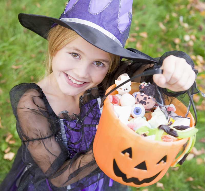 Kid with trick-or-treat bucket